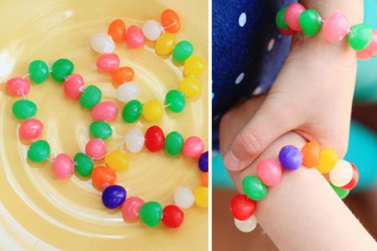 Make bracelets with jelly beans and thread.
