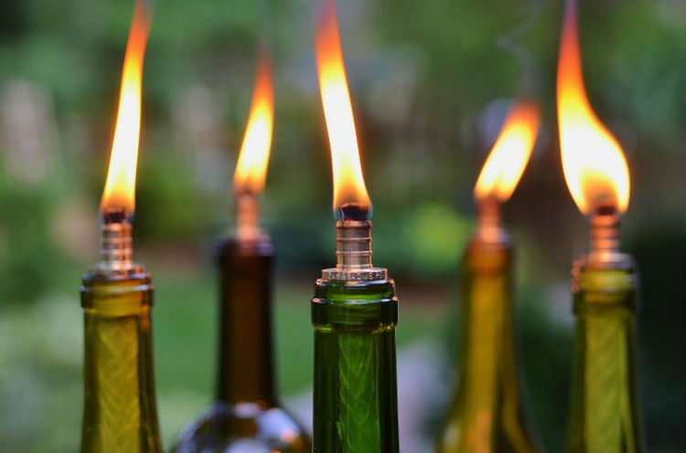Make Mosquito Repellent Tiki Torches With Empty Wine Bottles 24 Brilliant Backyard Party Ideas