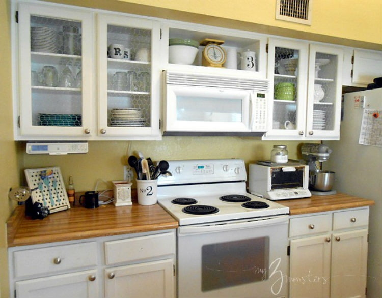 Replace the cabinet doors with chicken wire.