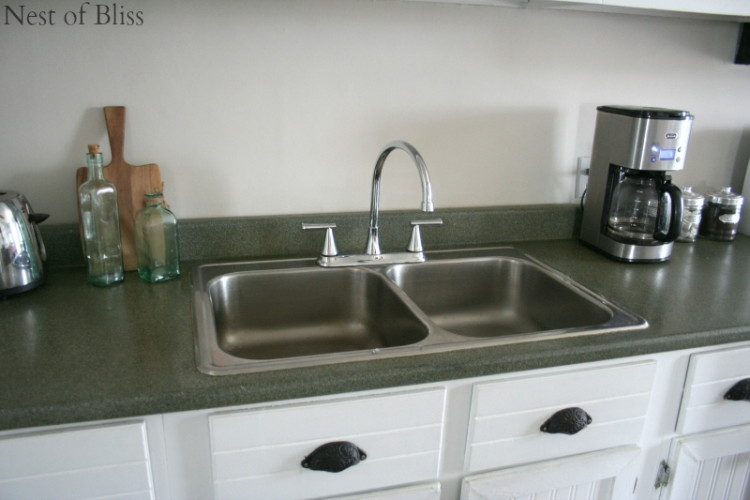 Spray paint your countertop a faux granite.