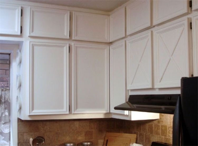 Add molding and trim to cabinet doors.