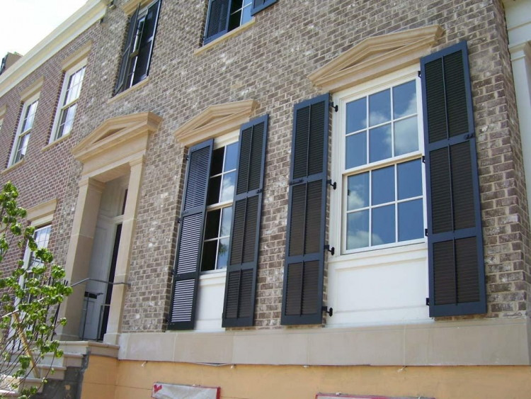 Install decorative shutters around your windows.