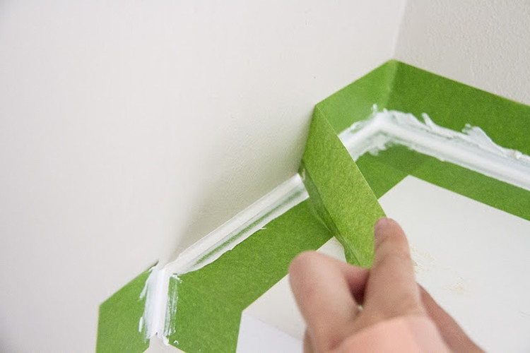 Get the perfect caulk edge with painter's tape.