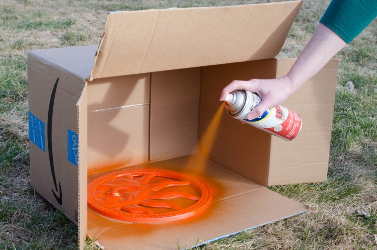 Prevent overspray with cardboard.