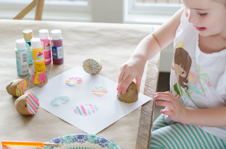 Use a potato to paint eggs.