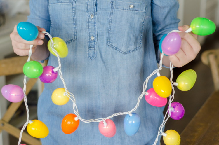 Attach plastic eggs to string lights.