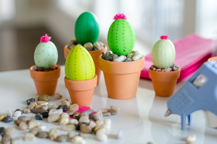 Paint or dye craft eggs, and set in terra-cotta pots for cactus Easter eggs.