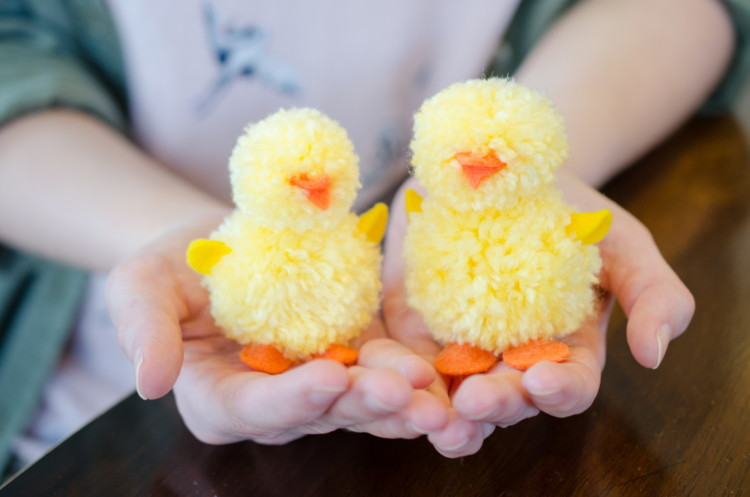 Make pom poms into Easter chicks.