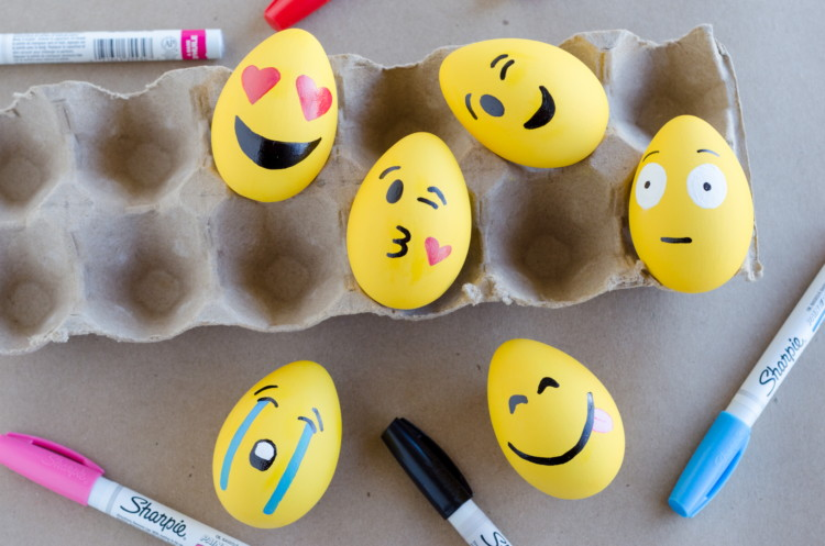 Make emoji Easter eggs with paint and markers.