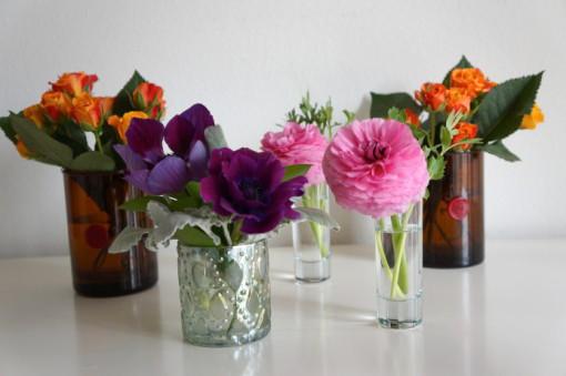 Reuse a candle jar as a flower vase.